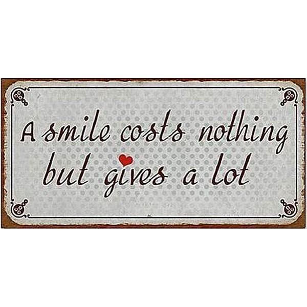 Magnet / Kylskåpsmagnet A smile costs nothing but gives a lot