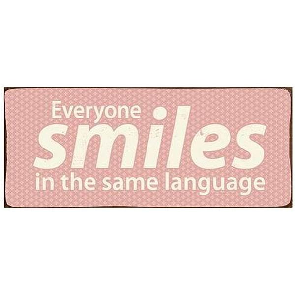 Plåtskylt Everyone smiles in the same language